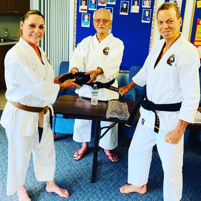 Cocoa Beach Karate student Lisa Miller was awarded her black belt by World Matsubayashi Karate Association10th degree Sensei Toshimutsu Arakaki, along with Cocoa Beach Karate sensei Des Chaskelson.