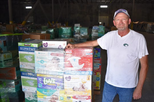 Crossroads Alliance & Ministries founder and President Steve Ewing, with some of the donated supplies for Hurricane Dorian relief to the Bahamas that are being temporarily stored at the Port Canaveral Logistics Center in Titusville.