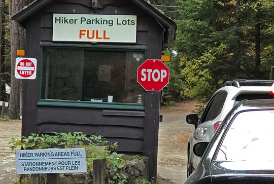 A sign at the Adirondak Loj in North Elba, NY, warns of full parking lots. Staff for the Adirondack Mountain Club reported that the lots there were full at 6:45 a.m. on Saturday, Sept. 28. 2019.