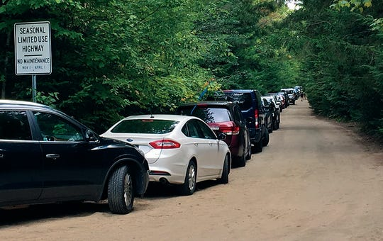 South Meadows Road, off the Adirondack Loj Road, in North Elba, NY, is packed with hundreds of cars in August. The road leads to several popular trail heads to the High Peaks region on the Adirondack Park.