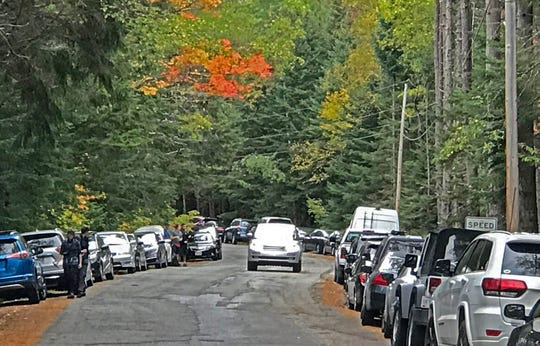 Adirondak Loj Road in North Elba, NY, is packed with hundreds of cars on Saturday, Aug. 28, 2019, on both sides of the road despite restrictions allowing for parking on just one side for safety reasons. The road leads to several popular trail heads to the High Peaks region on the Adirondack Park.