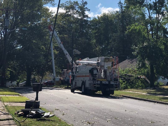 PSE&G crews worked to restore power to neighbors along Ramble Road in Cherry Hill on Sunday following a violent storm the night before.