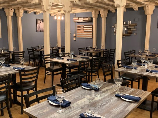 The first-floor dining room of Denim BYOB in Haddonfield.