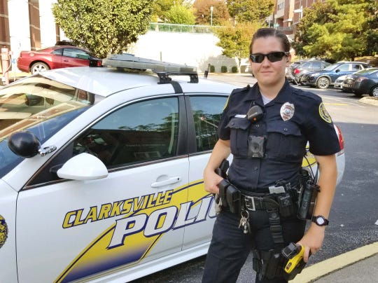 Clarksville Police Officer Victoria Crosby wears a body-worn camera in the middle of her torso. The camera joins an array of other equipment and tools mounted on her uniform.