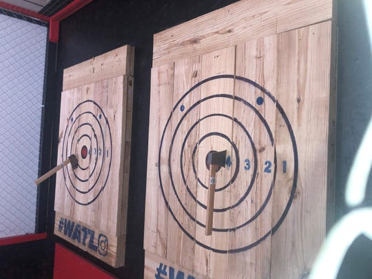 Arthur Finzen and Brandon Bishop, attempts target shots at Red Axe Throwing Company, Sept 27, 2019