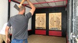 Red Axe Throwing Company Owner,Arthur Finzen, explains technique for ax throwing. This is the first ax throwing company in Clarksville