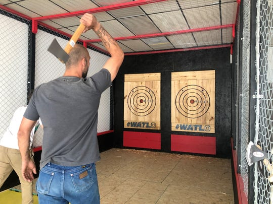Red Axe Throwing Company Owner, Arthur Finzen, throws an ax at a target. Sept. 27, 2019