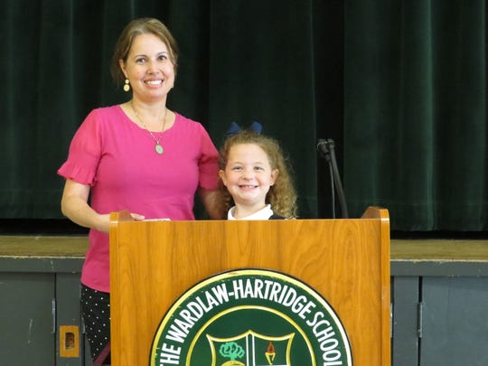 Lexington Donahue, pictured with Lower School Spanish teacher Maria Hinestroza, speaks to Lower School students during lunch about ways to help save the Earth.