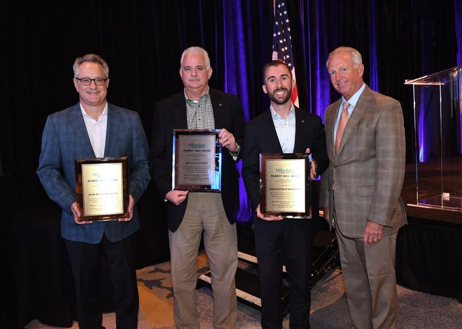 (Left to right) Robert Tartaglia, Kevin Runyon and Christopher Rozewski receiving their awards from NJBankers President and CEO John E. McWeeney, Jr.