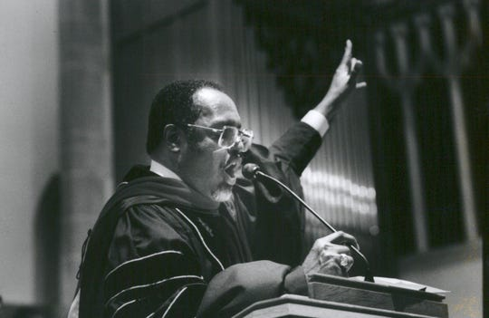 Rev. Charles G. Adams of Hartford Memorial Baptist Church in Detroit raises his hand during a reading of scriptures.