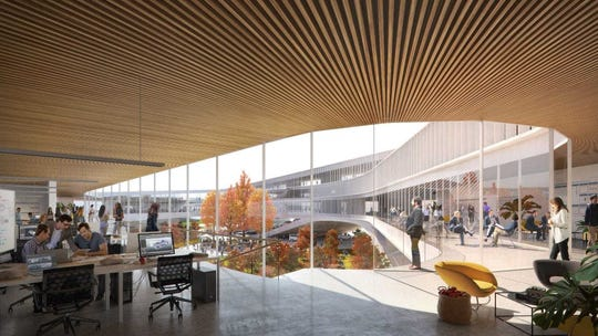 Rendering shows the interior of a Ford Motor Co. building in Dearborn as envisioned in its new campus plan. Ford said it is overhauling not just its physical space and how its many employees collaborate together.