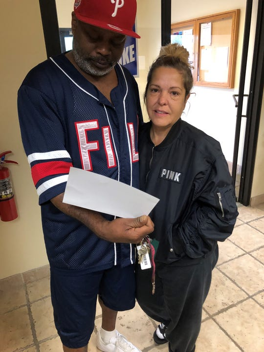 Henry Myles and wife Lauri Myles got his strike wage check at UAW Local 163 in Westland Monday. Henry Myles has worked at GM's Romulus Powertrain plant for three years.