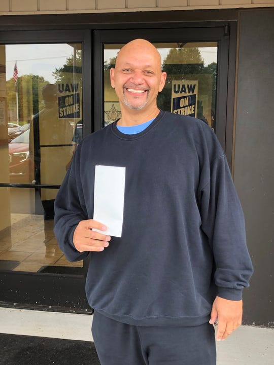 Theodore Mays gets his first $250 strike wage check at Local 163 which represents workers at GM's Romulus Powertrain plant where Mays works.