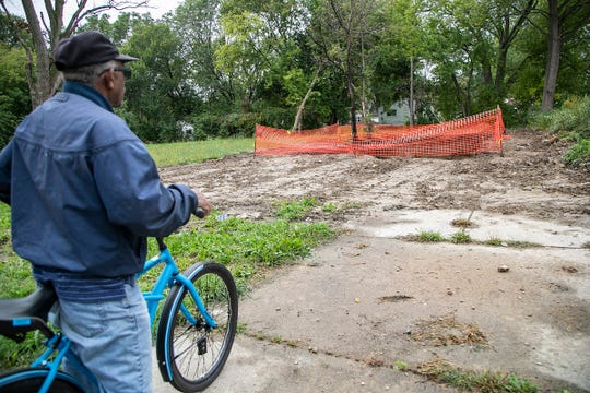 Neighbor Al Wilson, 72, stops by to look at what used to be the investment home owned by State Rep. Sherry Gay-Dagnogo Monday, Sept. 30, 2019. The house was torn down mysteriously and no one knows who is responsible.