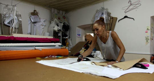 A seamstress works on a piece of white silk at Zeus+Dione atelier in Athens. Greece's centuries-old silk manufacturing tradition was nearly snuffed out during Greece's financial crisis., but the end of the crippling recession has raised demand.