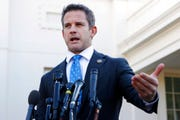 "In this March 6, 2019 file photo, Rep. Adam Kinzinger, R-Ill., speaks to the media at the White House in Washington.  Kinzinger is slamming as ""beyond repugnant"" President Donald Trump's tweet of a conservative pastor's comment that removing Trump from office would provoke a ""civil war."""