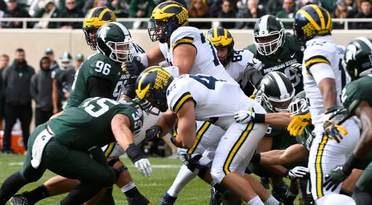 Michigan will play at Illinois at noon on Oct. 12, while Michigan State will play at Wisconsin at 3:30 p.m.
