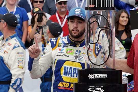 Chase Elliott poses with the trophy after winning the NASCAR Cup Series auto race at Charlotte Motor Speedway.