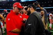 Lions coach Matt Patricia meets with Chiefs coach Andy Reid after Sunday's game.