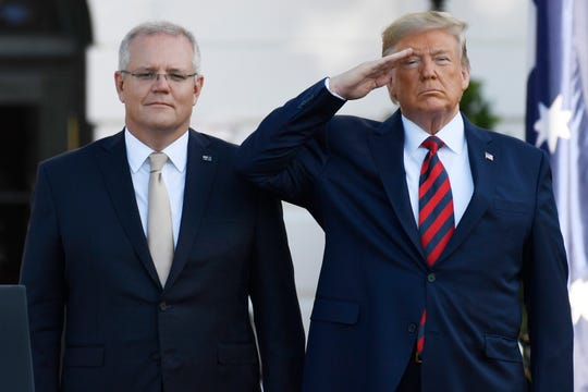 President Donald Trump and Australian Prime Minister Scott Morrison listen to the National Anthem during an State Arrival Ceremony on the South Lawn of the White House in Washington, Sept. 20.