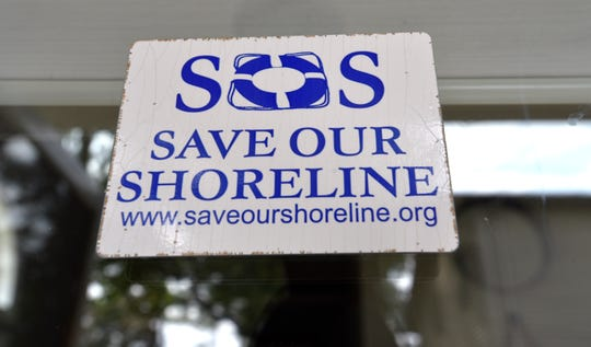 This sticker was displayed on the window of Killarney Beach resident Julie Schultz of Bangor Township.