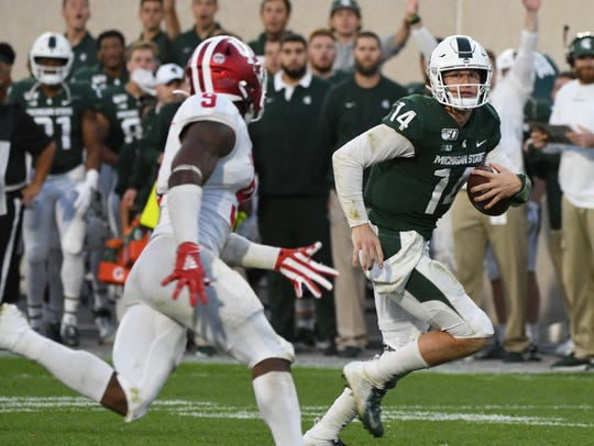 Quarterback Brian Lewerke (14) helped the Michigan State offense produce 34 points in its victory over Indiana.