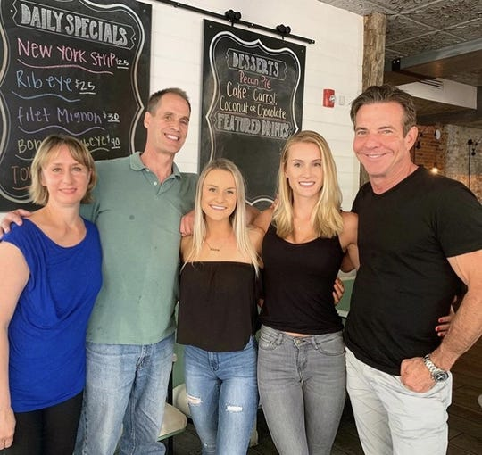 The Savoie family wtih Dennis Quaid. Laura's mother, father, Aimee, Laura and Dennis Quaid.