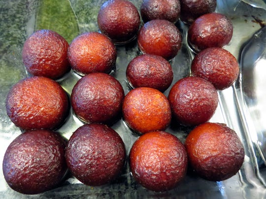 Gulab Jamun are a desert from South Asia. The rich balls are made with milk and flour, fried, and soaked in syrup.