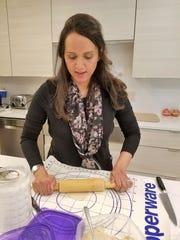 Samaira Ahmed rolls a dough wrapper for samosas on Wednesday, September 25, 2019.