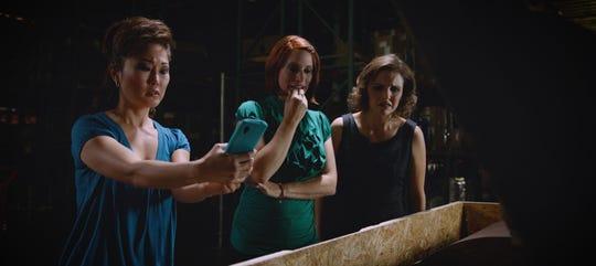 "From left, Cathy Shim, Jennifer Pfalzgraff and Amanda Melby star in ""Raising Buchanan."""