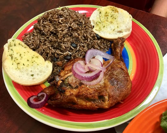 A $6.99 lunch special with slow-braised chicken, rice and beans from Luis Bakery Bar & Grill in Cape Coral.