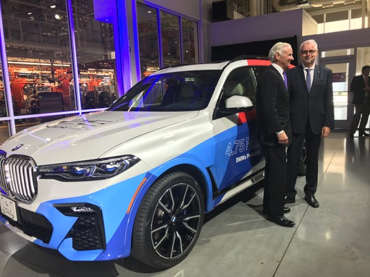 South Carolina Gov. Henry McMaster, left, poses with BMW Manufacturing President and CEO Knudt Flor in front of an X7 model commemorating the 25th anniversary of active production at the plant in Spartanburg. The plant remains BMW's largest in the world, with 294,306 X-model SUVs produced there so far in 2019.