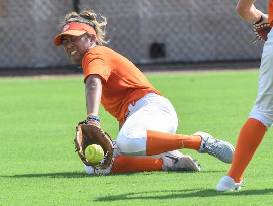 Clemson softball left fielder Arielle Oda dives for a fly ball during the first practice on their new field in Clemson Monday, September 30, 2019.
