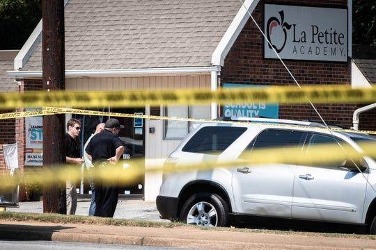Greenville County Sheriff deputies investigate a shooting on Old Spartanburg Road Monday September, 30, 2019, in Taylors which left one person dead in the parking lot of La Petite Academy.