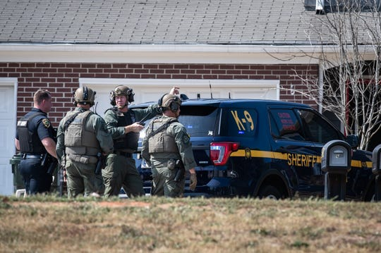 Greenville County Sheriff deputies search a home for a suspect involved in a shooting on Old Spartanburg Road Monday September, 30, 2019, in Taylors which left one person dead in the parking lot of La Petite Academy.