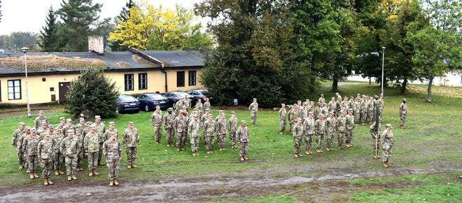 U.S. Army Reserve Soldiers from the 652nd Regional Support Group stand in formation on Powidz Air Base in Powidz, Poland, shortly before a ceremony uncasing the unit colors in Poland. The Soldiers arrived in Poland September 26 to begin a mobilization to Poland where they will be the first Army Reserve unit responsible for the operations of 10 base camps throughout the country. (U.S. Army Reserve photo by Master Sgt. Ryan C. Matson, 652nd Regional Support Group)