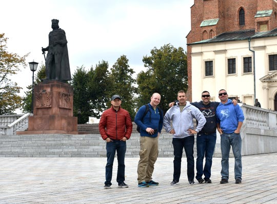 U.S. Army Reserve Soldiers from the 652nd Regional Support Group stand in front of the monument of Boleslaw the Brave, first king of Poland, September 28 in Gniezno, Poland. The Soldiers arrived in Poland September 26 to begin a mobilization to Poland where they will be the first Army Reserve unit responsible for the operations of 10 base camps throughout the country. (U.S. Army Reserve photo by Maj. Olha Vandergriff, 652nd Regional Support Group)