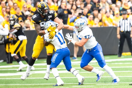 Iowa defensive end A.J. Epenesa (94) gets double teamed by Middle Tennessee State's Brad Anderson (11) and Dalton Frantz (47) during a NCAA non conference football game between the Iowa Hawkeyes and Middle Tennessee State, Saturday, Sept., 28, 2019, at Kinnick Stadium in Iowa City, Iowa.