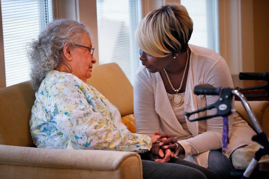 Judy Goeglein (left) hears kind words of support from Joy's House staff member Theresa Bonner.