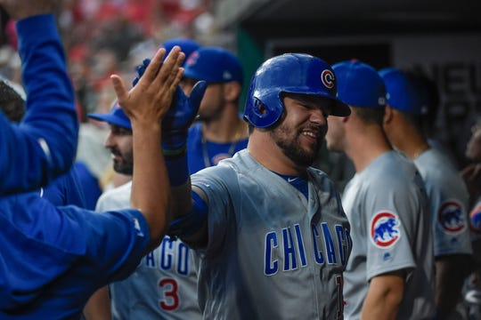 Chicago Cubs left fielder Kyle Schwarber (12) is congratulated by teammates after hitting a solo home run against the St. Louis Cardinals during the first inning at Busch Stadium.