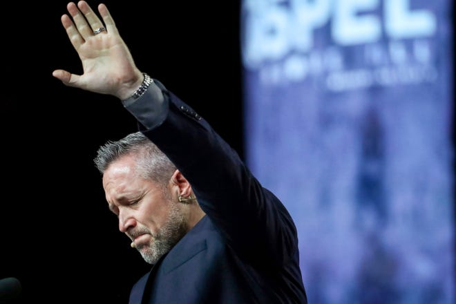 In this June 12, 2019 photo, J. D. Greear, president of the Southern Baptist Convention, talks about sexual abuse within the SBC on the second day of the SBC's annual meeting in Birmingham, Ala.