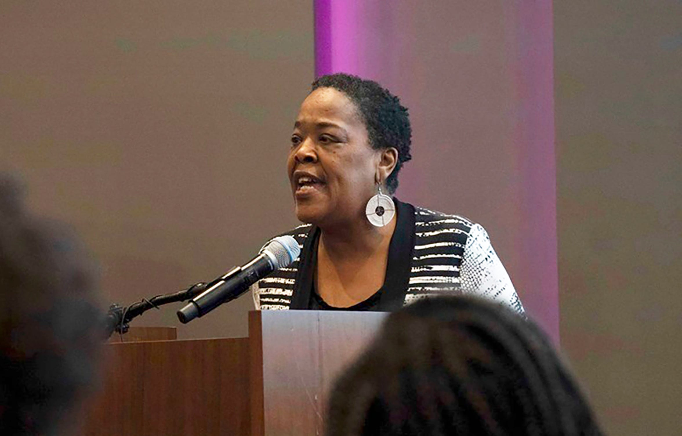 In this June 20, 2019 photo provided by Meredith Williams, Jaribu Hill speaks at the Mississippi Civil Rights Museum in Jackson, Miss., during a reception honoring the life of civil rights activist Unita Blackwell.