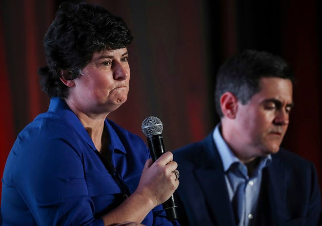 In this June 10, 2019 photo, Susan Codone, left, shares her story of being sexually abused during a panel discussion about sexual abuse and the Southern Baptist Convention, as Russell Moore, right, president of the Ethics and Religious Liberty Commission of the SBC, listens on the eve of the SBC's annual meeting in Birmingham, Ala.