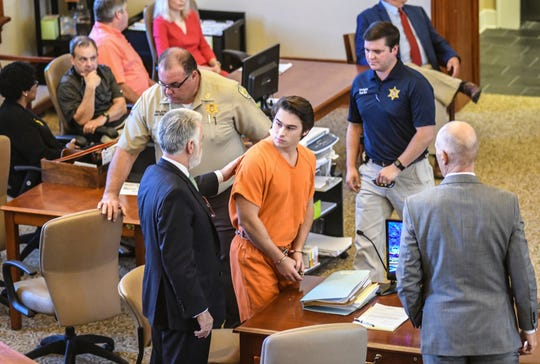 """Brandon A. Theesfeld, center, looks over at his attorney Tony Farese before the start of a hearing where he was indicted for capital murder in the death of Alexandria """"Ally"""" Kostial of St. Louis, Mo., at the Lafayette County Courthouse in Oxford, Miss. on Monday, September 30, 2019. Theesfeld pleaded not guilty."""