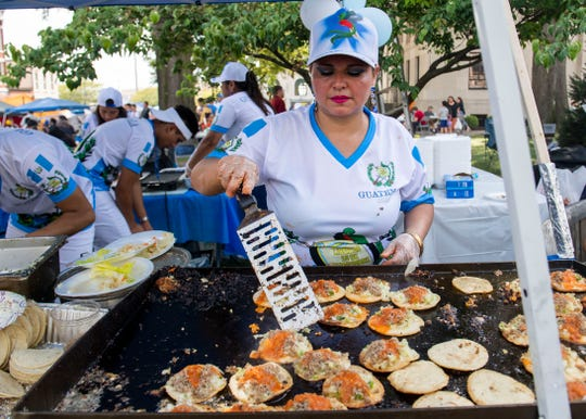 Zoy De Garcia cooks a Guatemalan dish during the International Food and Art Festival at the courthouse square in Jackson, Tenn., Saturday, Sept. 28, 2019.