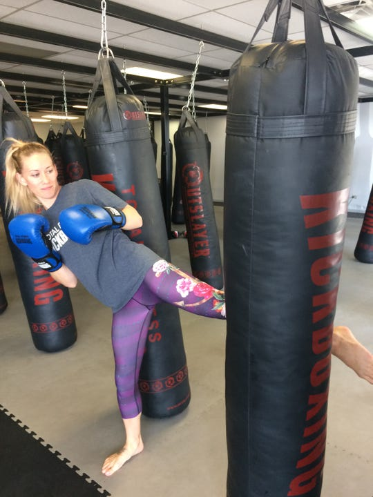 Instructor Misty Weimer of Knoxville shows the proper technique for a kick.