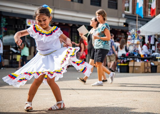 Ximena Castano, 5, twirls in her traditional Colombian dress during HoLa Fest on Monday, Sept. 30, 2019 in Market Square in downtown Knoxville.