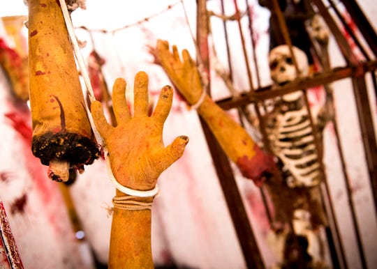 Severed limbs dangle from above inside Dead Man's Farm haunted attraction at its new location in Philadelphia on Monday, Sept. 30, 2019.