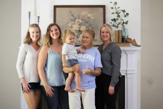 Sherry Bandy, center with grandson Griffin Mertz and daughters, from left, Emily Roberts, Olivia Mertz and Trudi Johnson. Roberts helped source items and decorate, Mertz worked alongside her mother remodeling the house and Johnson helped find and list the Barbara Drive house now that it has been painstakingly remodeled.