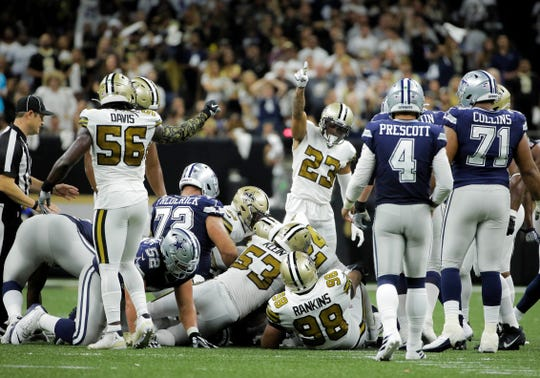 Sep 29, 2019; New Orleans, LA, USA; New Orleans Saints cornerback Marshon Lattimore (23) signals that the strong safety Vonn Bell (not pictured) recovered a fumble during the second quarter against the Dallas Cowboys at the Mercedes-Benz Superdome. Mandatory Credit: Derick E. Hingle-USA TODAY Sports